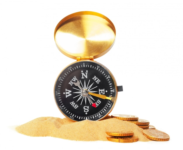 Compass on the sea sand