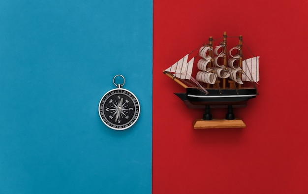 Compass and ship on a red-blue