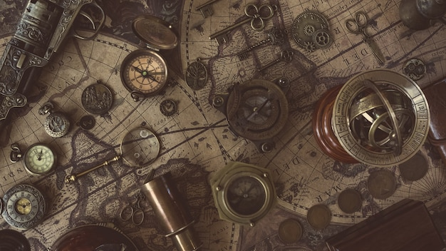 Compass with old collectible on old world map