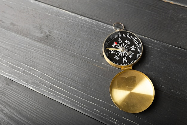 Compass on the wooden table