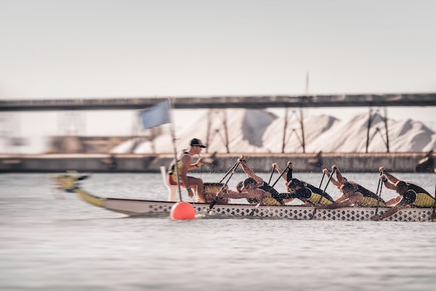 A competing dragonboat team in action