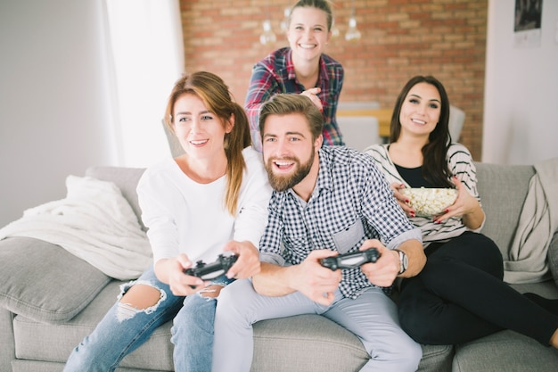 Competing friends playing videogame on party