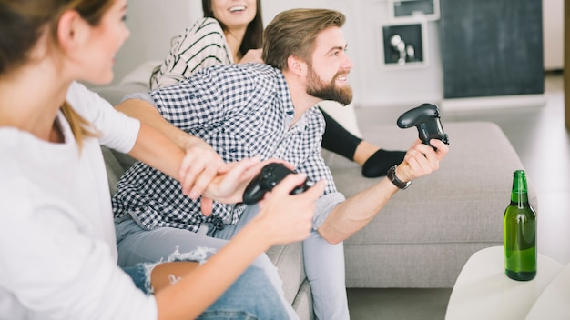 Competitive friends enjoying videogame on party