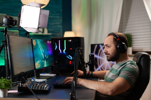 Competitive player streaming esport tournament using technology network wireless competitive woman playing online space shooter competition on powerful professional computer talking into microphone
