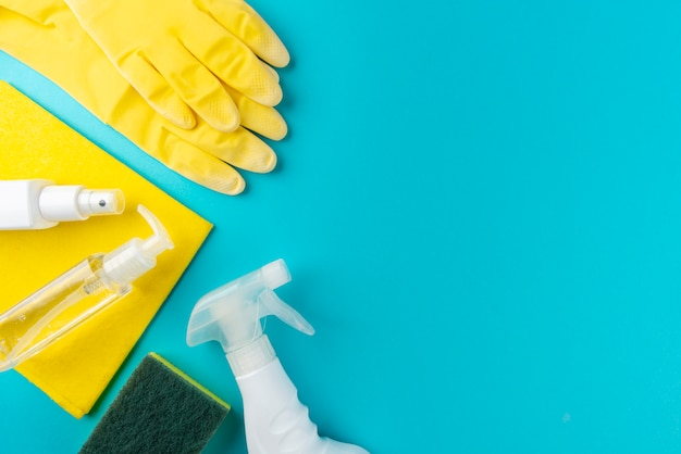 Complete cleaning items on blue wall. cleaning concept.