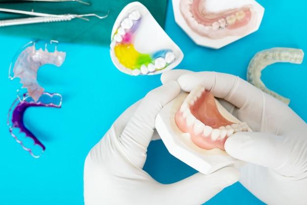 Complete denture or full denture on blue.