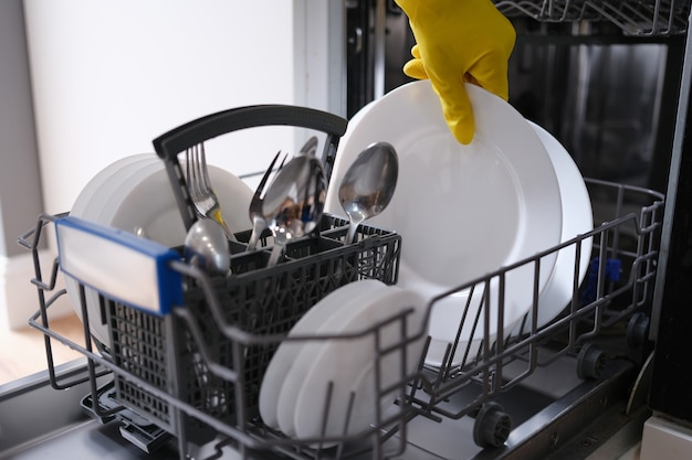 Complete dishwasher with clean washed dishes. household appliances in the kitchen concept