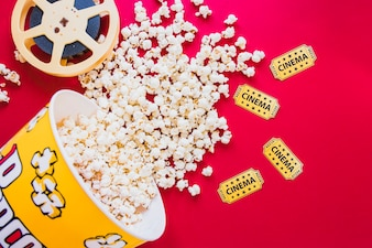 Composed bucket of popcorn and filmstrip