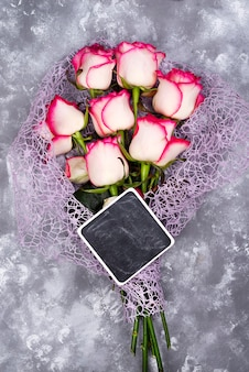 Composed of the roses and chalkboard