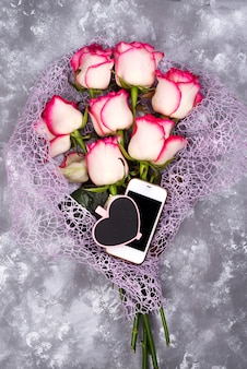 Composed of the roses and mobile phone adn chalkboard heart