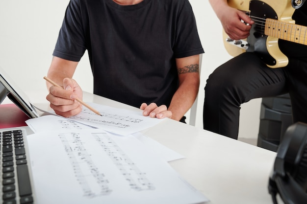 Composers writing musical notes
