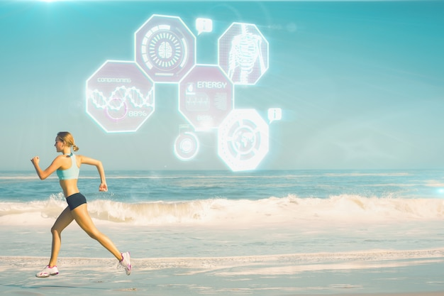 Composite image of fit woman jogging on the beach