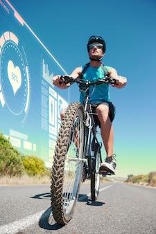 オープンロードでサイクリングする運動選手の合成画像