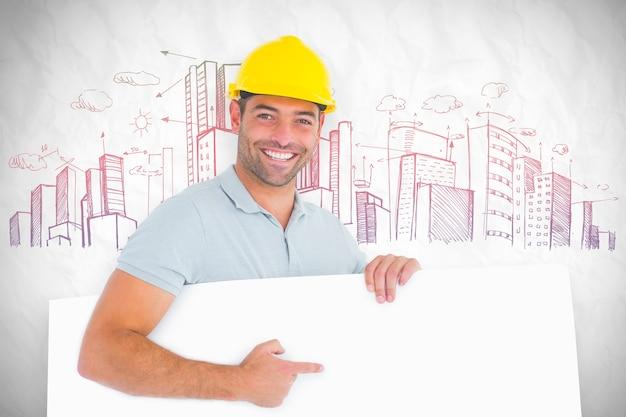 白い背景の上の空白のボードを指している職長の合成画像