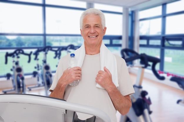 Composite image of senior man on the treadmill
