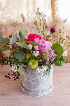 Composition of autumn flowers in a hat box