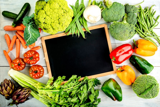 Composition of autumn green vegetables with chalkboard