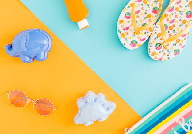 Composition of beachfront accessories on multicolored background