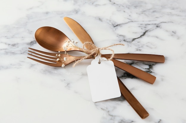 Composition of beautiful tableware with empty tag