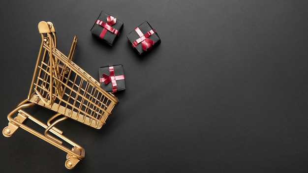 Composition of black friday shopping cart with copy space