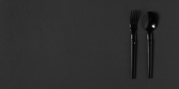 Composition of black tableware with copy space