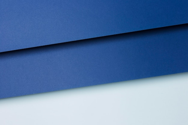 Composition of blue paper sheets background