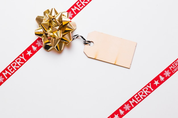 Composition of bow with christmas greeting card