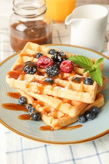 Composition of breakfast with belgian waffles