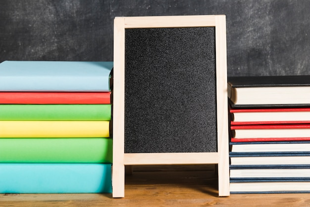 Composition of chalkboard and multicolored books