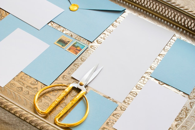 Composition of colored sheets and scissors