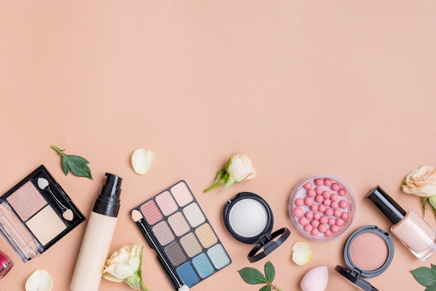 Composition of cosmetics with copy space on beige background