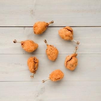 Composition of crusty golden chicken drumsticks