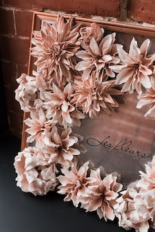 Composition of decorative artificial flowers. interior decoration with flowers. floral interior