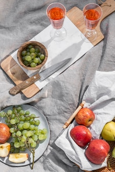 Composition of delicious picnic goodies on a blanket