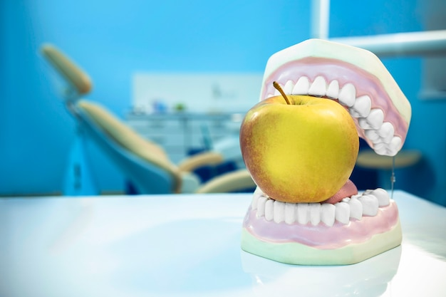 Composition. dentures biting an apple in dental surgery