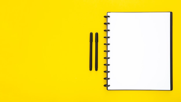 Composition of desk elements on yellow background