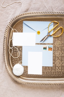 Composition of envelope and papers on tray