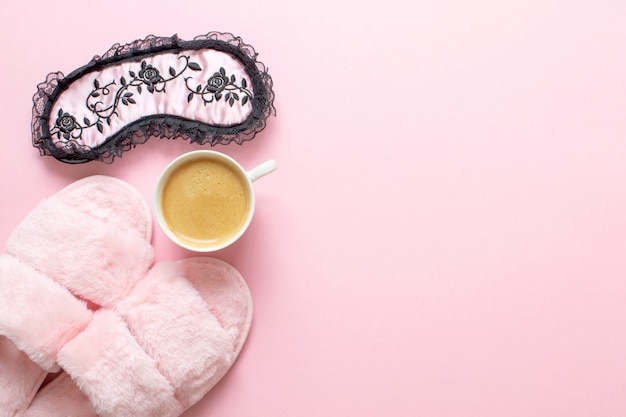 Composition of faux fur slippers and healthy breakfast on light pink