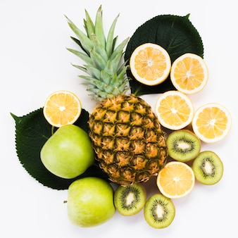 Composition of fresh exotic fruits on white background