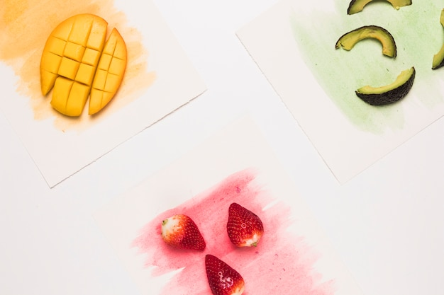 Composition of fruits on colored watercolor surface