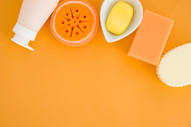 Composition of health care products on orange background