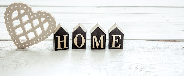 Composition in hygge style with the wooden word home
