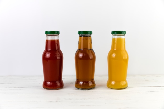 Composition of juice bottles on table