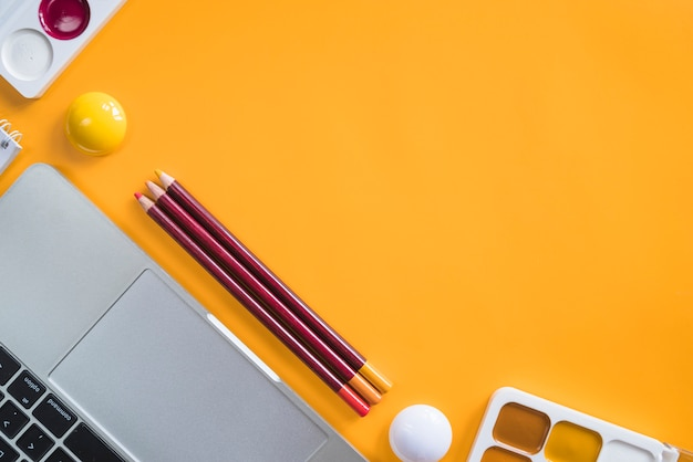 Composition of laptop and stationery tools for painting