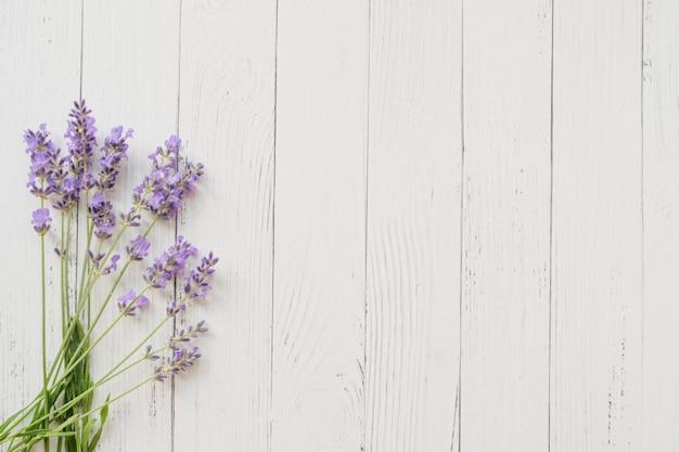 Composition of lavender on white wooden . violet summer flowers.