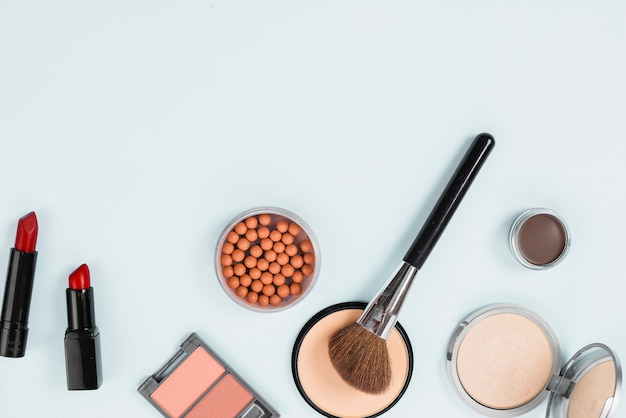 Composition of makeup beauty accessories on light background