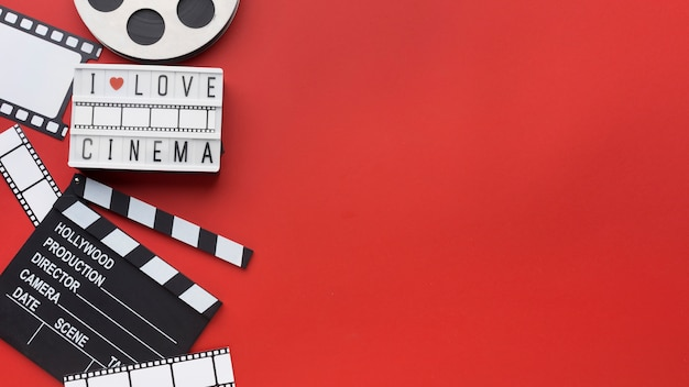 Composition of movie elements on red background with copy space
