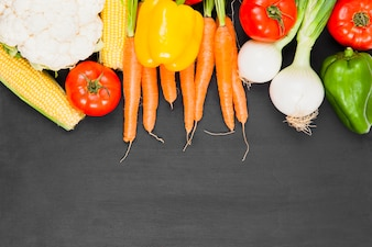 Composition of fresh vegetables with space on bottom