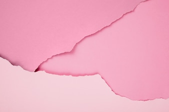 Composition of ripped pink papers