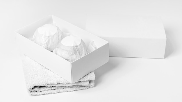 Composition of packaged bath bombs on white background